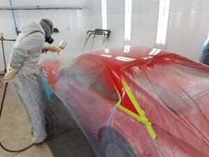 auto body technician in spray booth